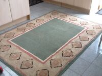 Polypropylene rug 160cm x 220cm in green,beige and shades of peach and pink-vacuumed and cleaned