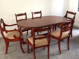 Regency style reproduction rosewood table & 6 chairs (2 carvers), originally from Beresford & Hicks