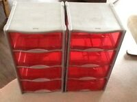 Two sets of Curver red and grey drawers.