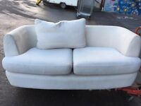 2 seater cloth sofa. Ex display. Few scuffs from storage. Needs a clean.FREE