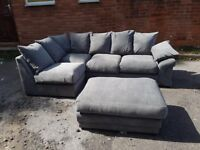 Stylish BRAND NEW grey fabric corner sofa and footstool,small rip ,can deliver