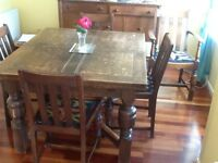 Dining table and 5 chairs. Dark wood, 2 extending leaves. Would suit older house.