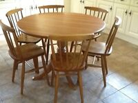 Solid wood round kitchen table and six chairs