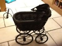 Victorian style pram suitable for porcelain dolls. Lovely condition. Used as display for pot dolls