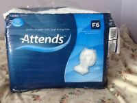 F6, 40 white small adults incontinence slip pads.