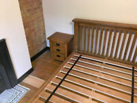 Sold oak beautiful double size bed frame in very good condition, 2 bedsides and free mattress