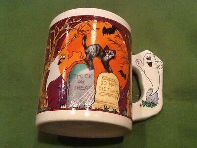 Halloween mug with bats, cats, ghosts and jack-o-lantern decor