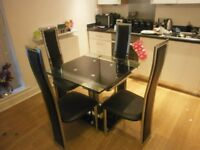 Elegant black extending dining table & 6 chairs