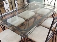 Quality glass table and six chairs strong and sturdy set.