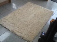 100% pure wool pile shaggy rug 102cm x 152cm in cream from NEXT -vacuumed & cleaned,great condition