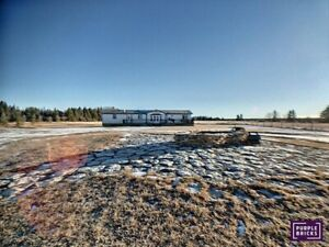 Acreage just outside Sundre with stunning mountain views!!!