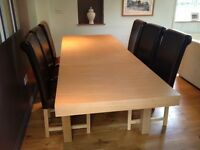 Modern extendable light oak dining table and six chairs. Excellent condition.
