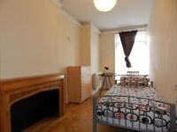 2 Spacious Single Rooms in Beautiful International House. All bills included. Zone 2