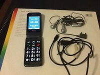 TT mobile phone, charger & earpiece