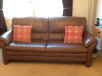 Two 3 seater leather couches in brown