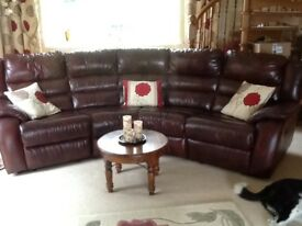 Leather suite antique red curved 4 seater settee recliners each end and on chairs. £399.00 ono
