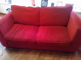 Red two seater sofa. Excellent condition. Fabric material.