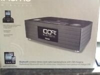 iHome Wireless Bluetooth stereo clock radio/ speakerphone with sub charging.