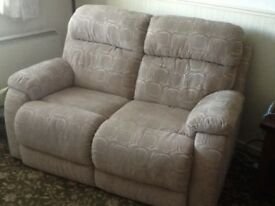 Fabric beige two seater sofa