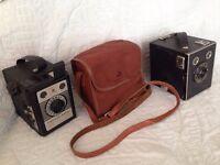 Two old vintage box brownie cameras.