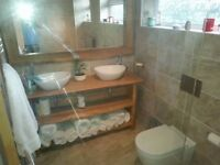 Bathroom fitting, plumbing and tiling services