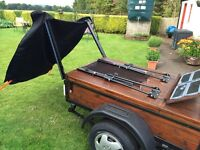 Car Trailer - Metal framed Trailer with wooden sides and top.