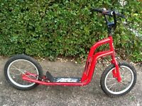 Large child's scooter in red