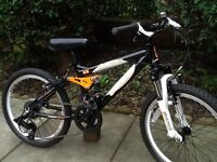 Carrera detonate dual suspension child's mountain bike