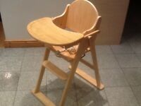 Solid wood highchair with swing-over tray/table-used but in great condition-folds for transport