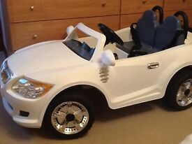Childs 12v two seater car. White in colour.