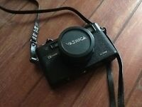 Antique Yashica camera in black leather cover and accessories, excellent condition,