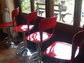 Set of four Barr stools ,red and crome , in good codition, but used ,