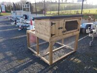 Wooden rabbit hutches dog kennels and hen arks