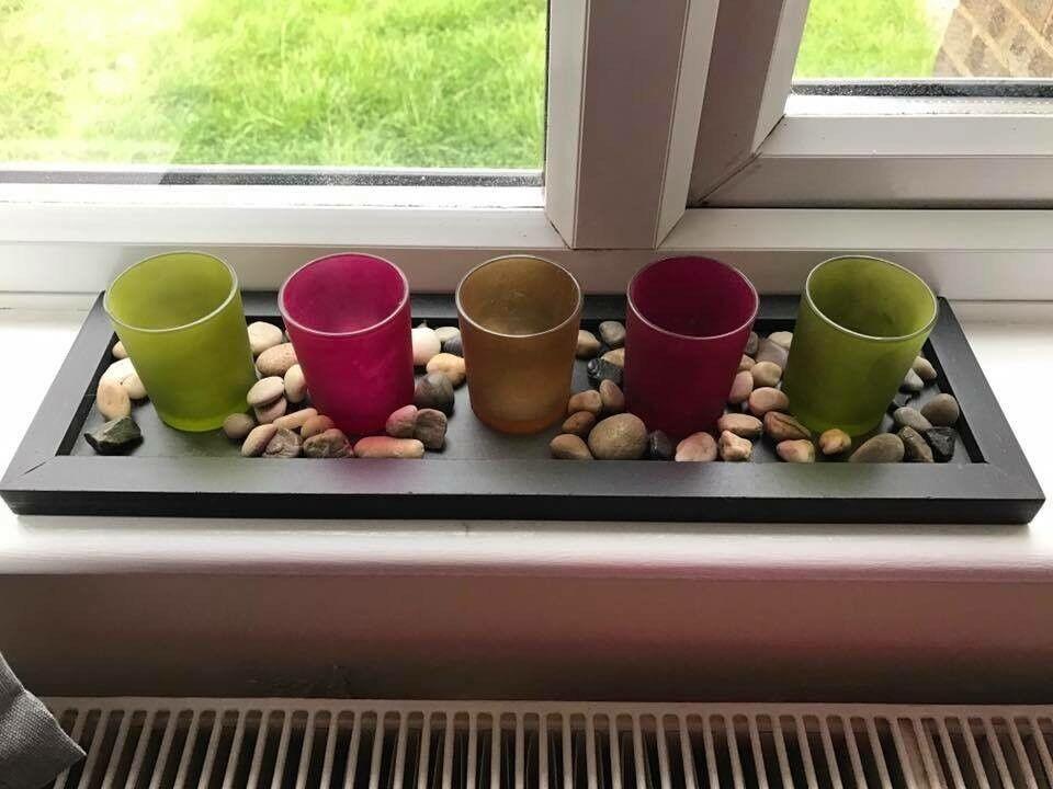 Tea light holder with stones