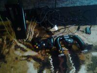 xbox360elite 250gb, steering wheel, rechargable batteryies, 18games