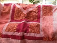 Handmade single patchwork quilt in reds