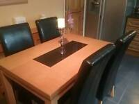 ..TABLE AND 4 CHAIRS..+ CANDLESTICK..immaculate order..1 year old..