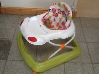 Baby walker in excellent condition for toddlers 6mth upwards-padded seat is removable & been washed