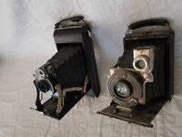 Two vintage box brownie cameras.