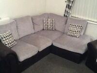 Grey fabric corner sofa and armchair