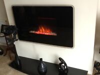 Wall mounted electric fire and marble hearth