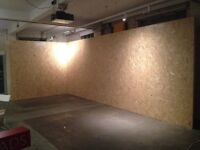Ready made freestanding temporary OBS board walls, with timber and sandbags.