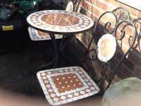Mosaic garden table and 2 chairs.