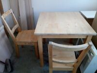 IKEA Pine dining table and four chairs
