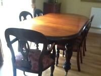 Extending dark wood table and 2 carvers 4 chairs
