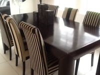 Large solid wood dining table with 6 modern high backed chairs