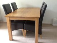 Solid oak 5ft x 90cm dining table with 4 real leather chairs.