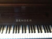 Zender piano with piano stool. ideal for learner.