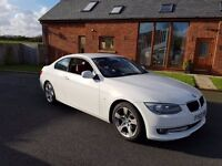 For Sale: BMW 3 Series 320i Coupe. Beautiful car with a stunning red leather interior. Great mileage