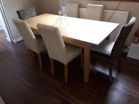 Expandable Dining table (wooden) and 6 chairs (4 leather + 2 wicker)